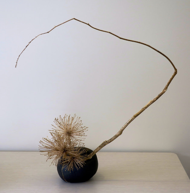 Ikebana arrangement of dried branches, perfect décor in a minimalist interior.
