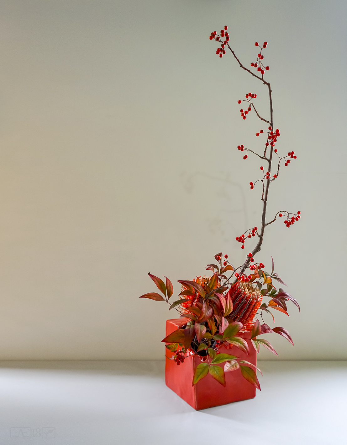 Totally asymmetric Ikebana arrangement, perfect décor in a minimalist interior.