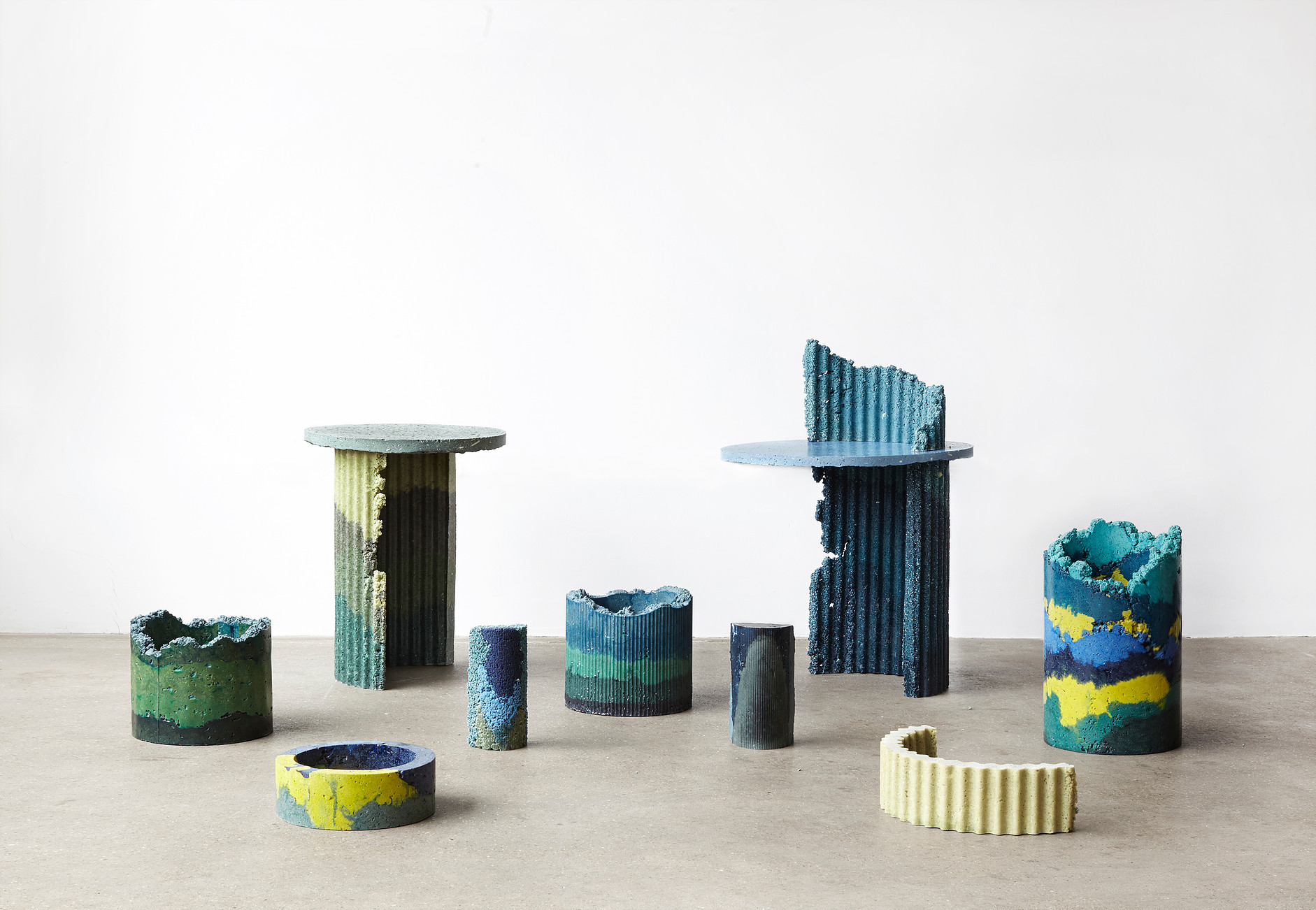 Charlotte Kidger recycled plastic vases and tables.