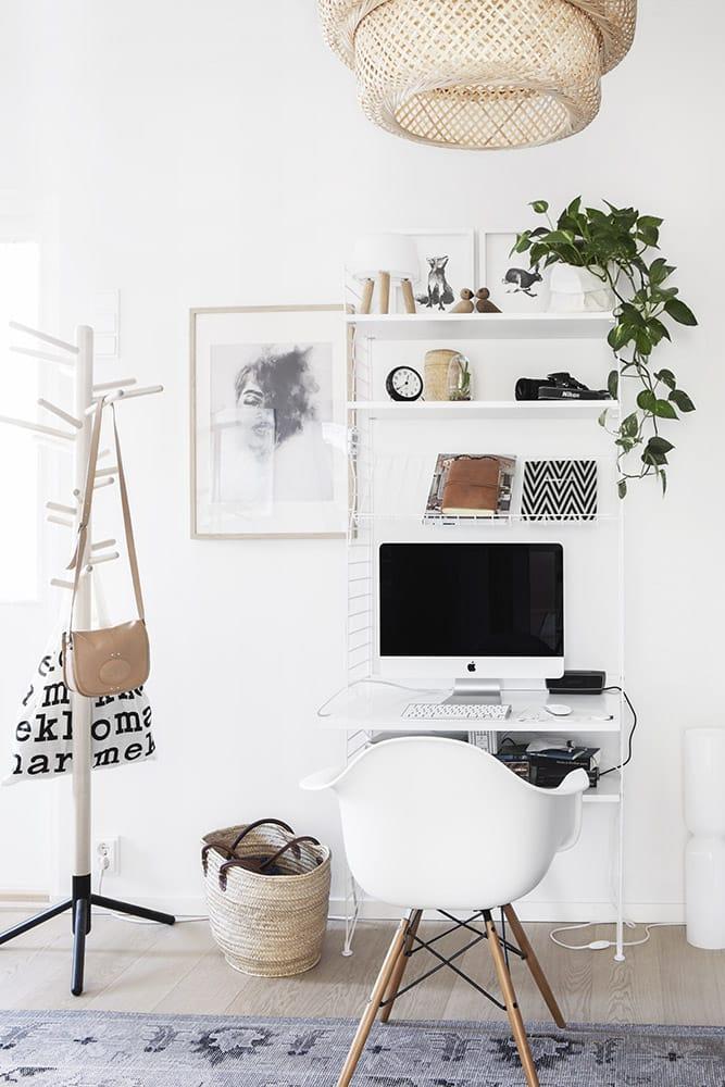 Small home office desk in a bookshelf.