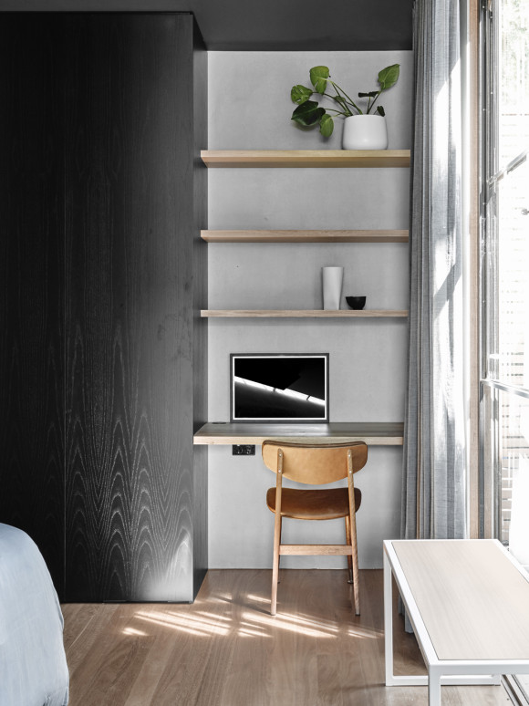 Small home office desk on a shelf.