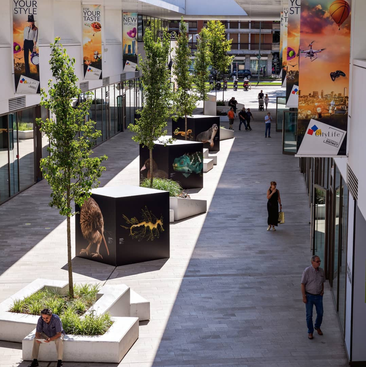 A closer outdoor view of CityLife shopping district, an example of biophilic design.