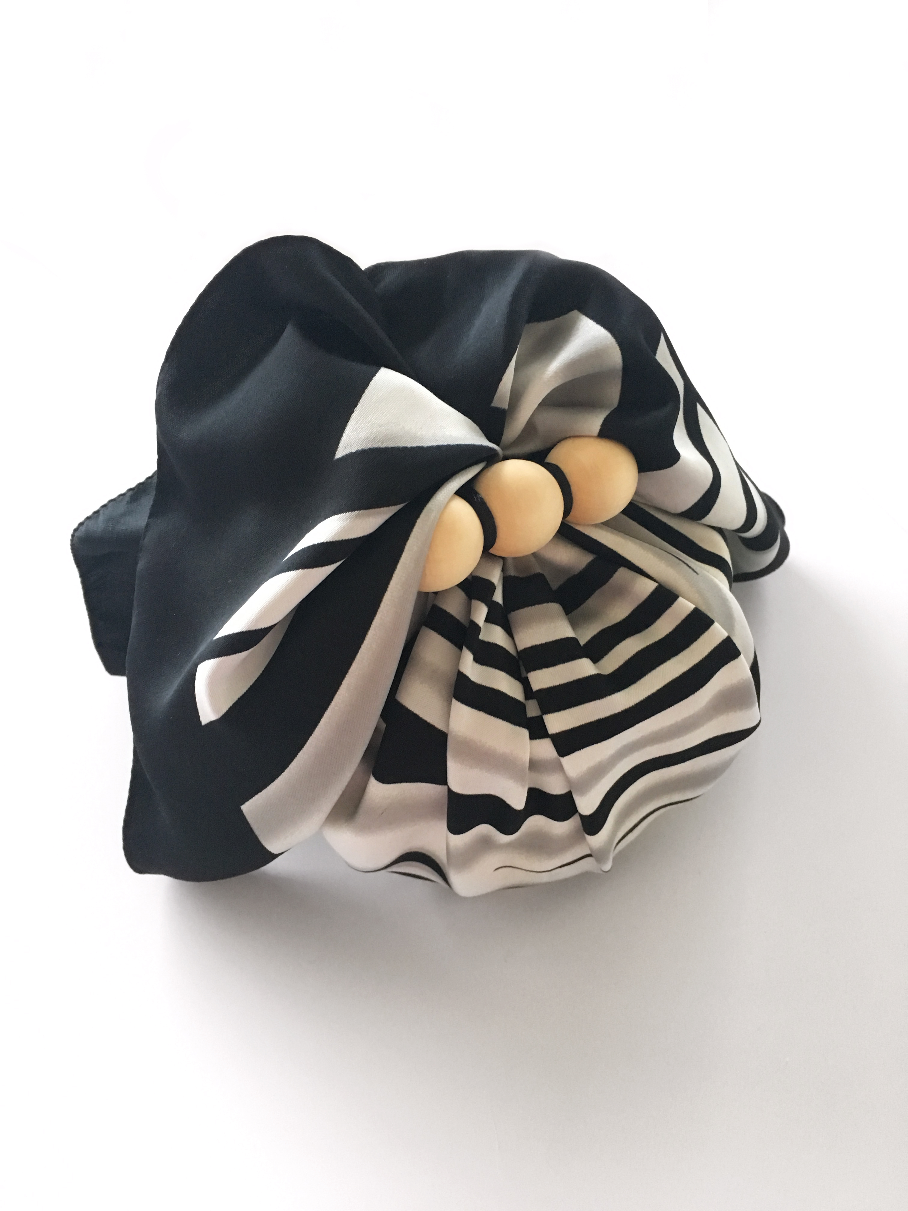 Gift wrapped into a scarf as an example of sustainable gift wrapping.