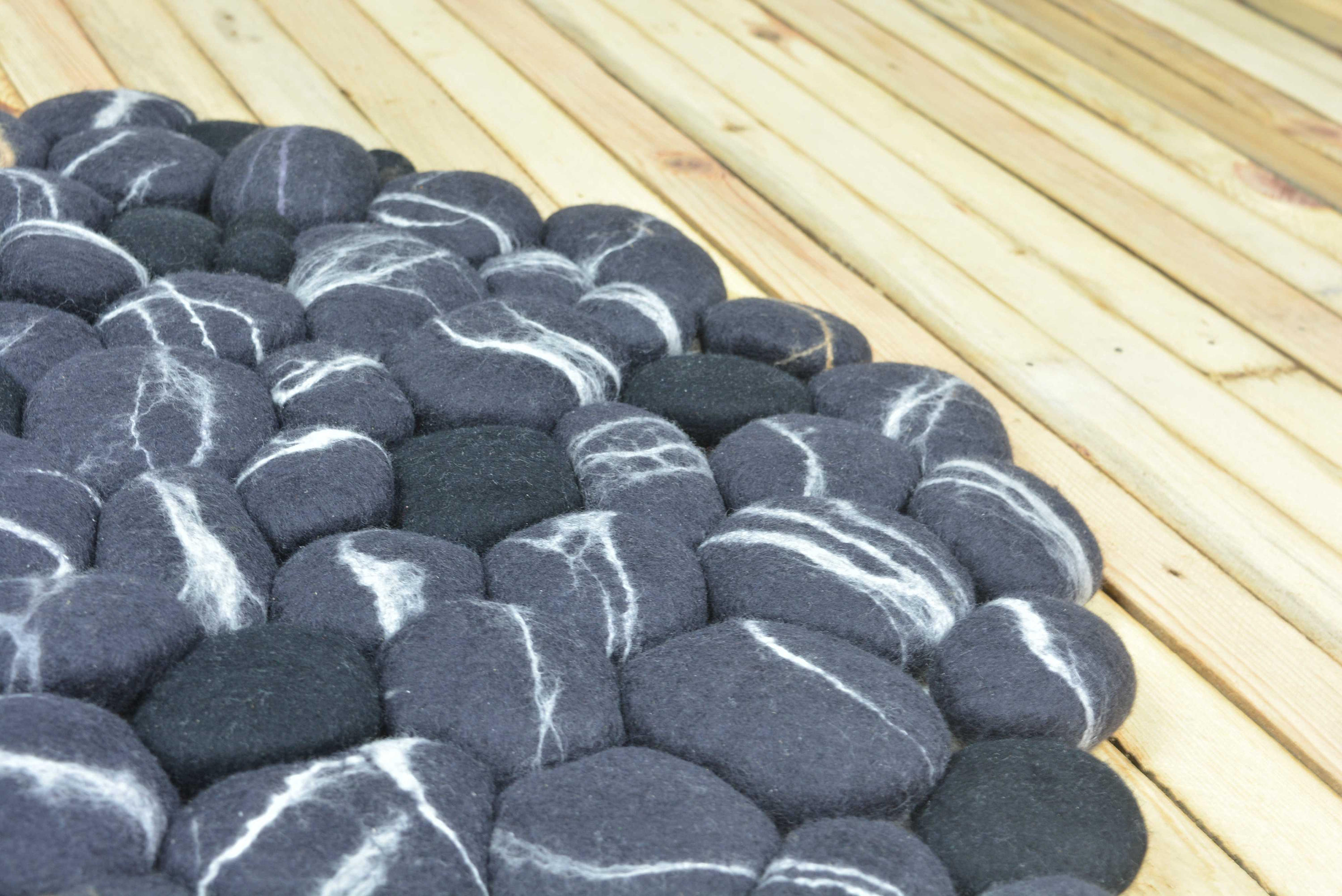 Close-up of a felt stone rug.