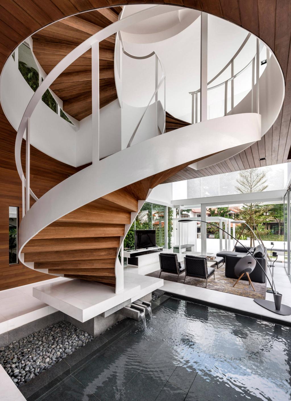 Pond below a modern staircase.