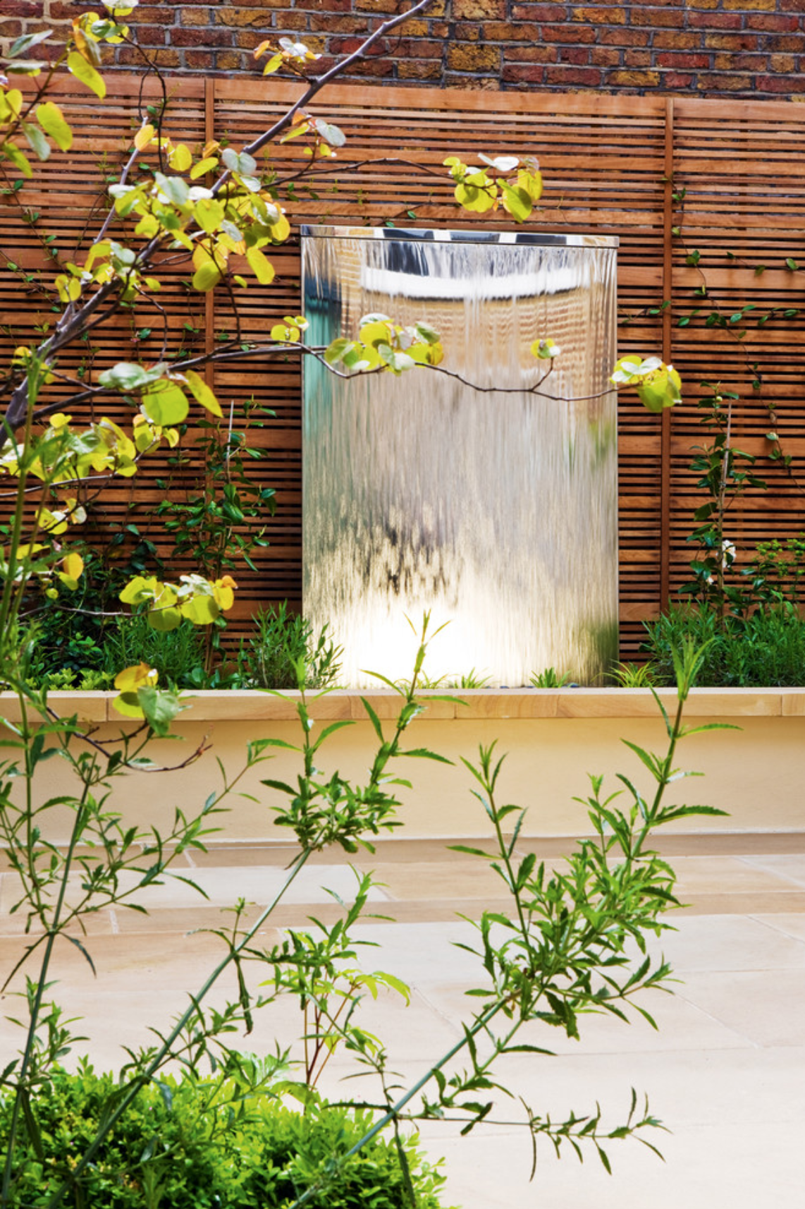 Outdoor water wall, great element to a biophilic outdoor design.