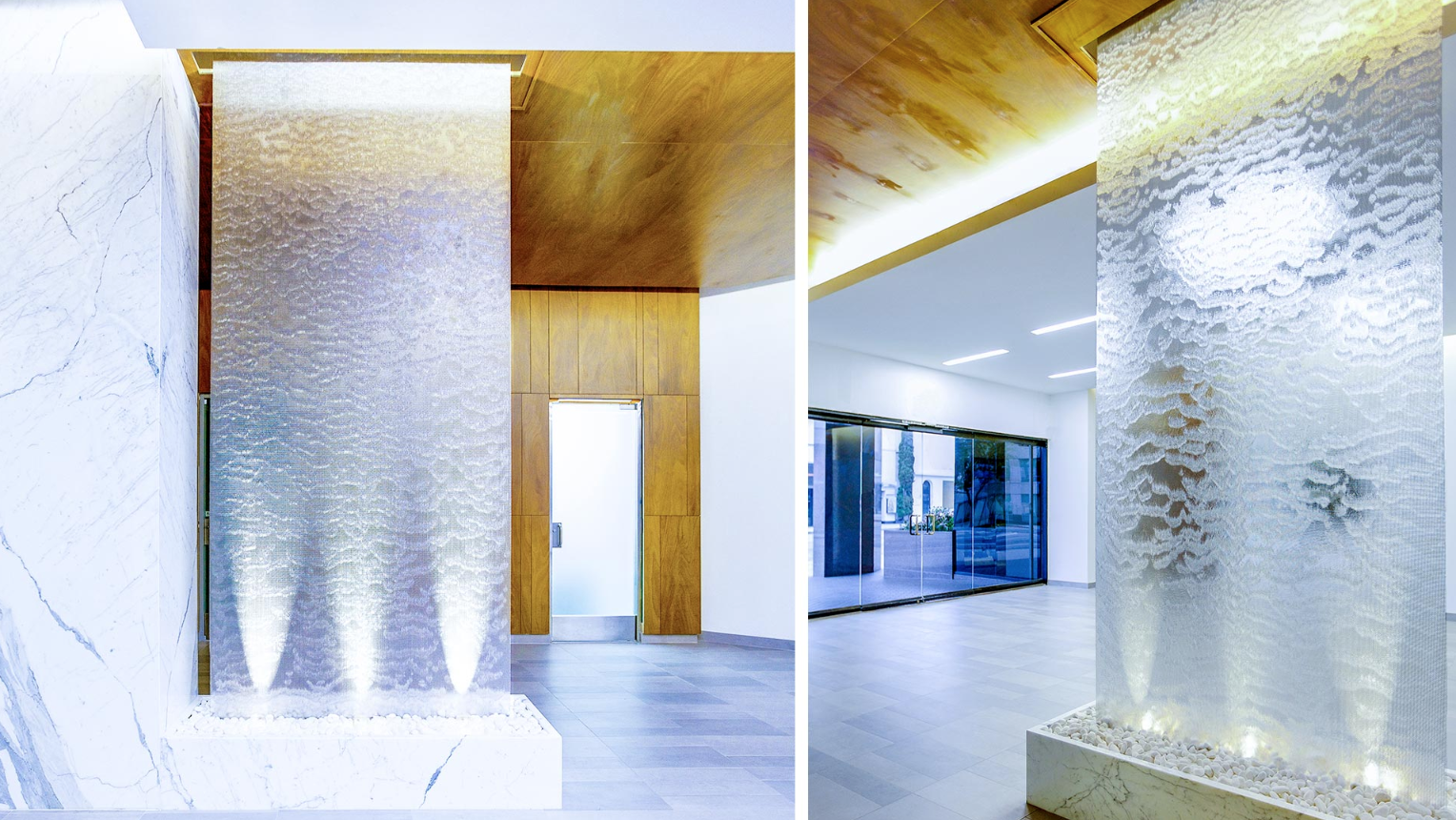 Indoor water wall acting as a room divider.