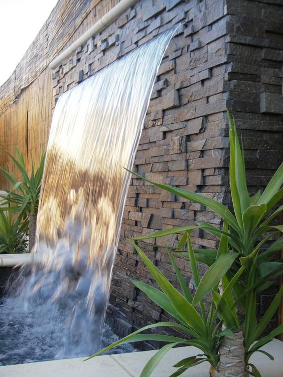 Outdoor waterfall feature.