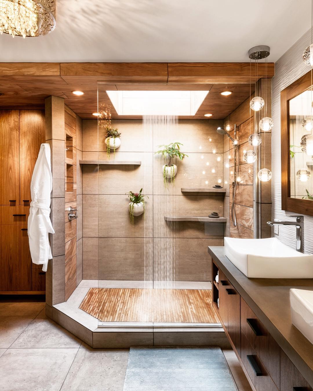 Natural bathroom design with plants hang on the wall into the shower.