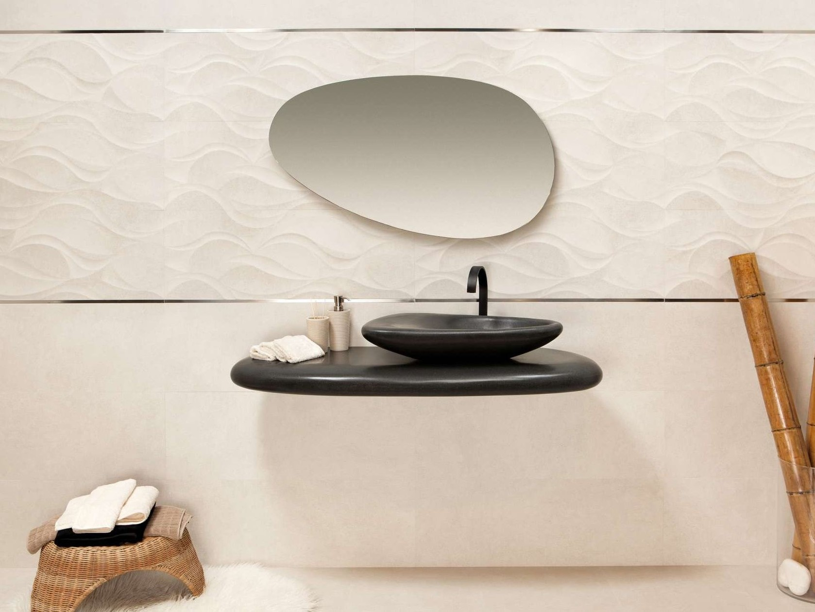 Bathroom with all organic rounded shapes, from the vanity to the sink to the mirror.