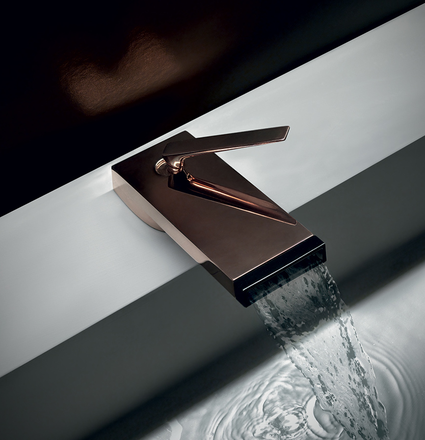 A waterfall faucet on a modern bathtub, adding a biophilic twist to a natural bathroom design.
