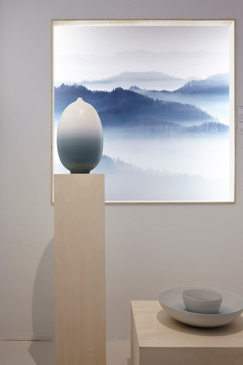 A blue foggy landscape artwork and two sculptural vases exposed at the Maison et Objet's exhibition on silence.
