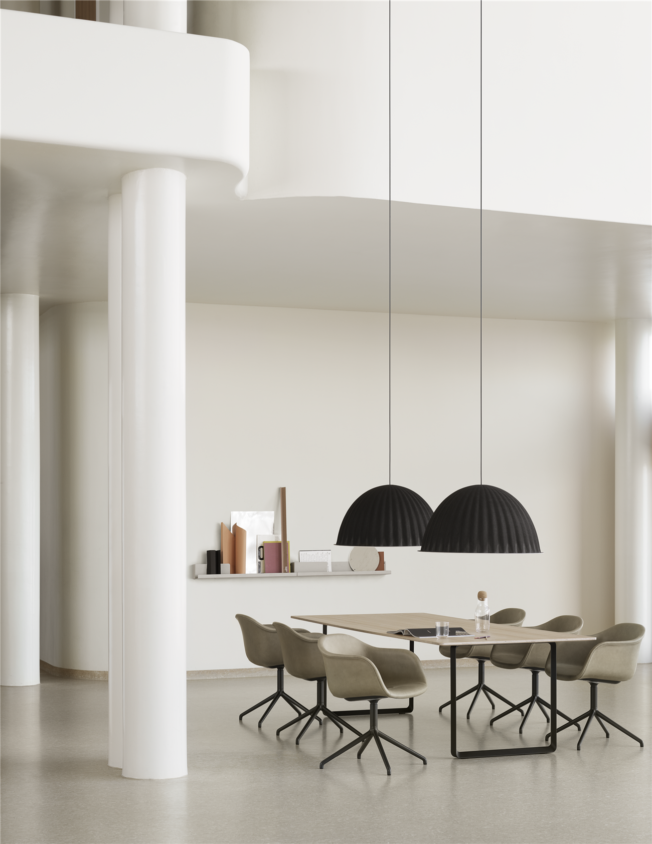 Minimal dining room with huge soudproofing pendant lights above the table.