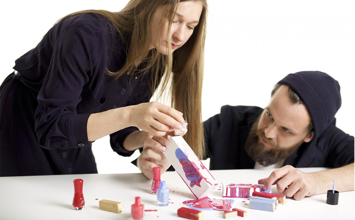 Designers experimenting with nail polish.