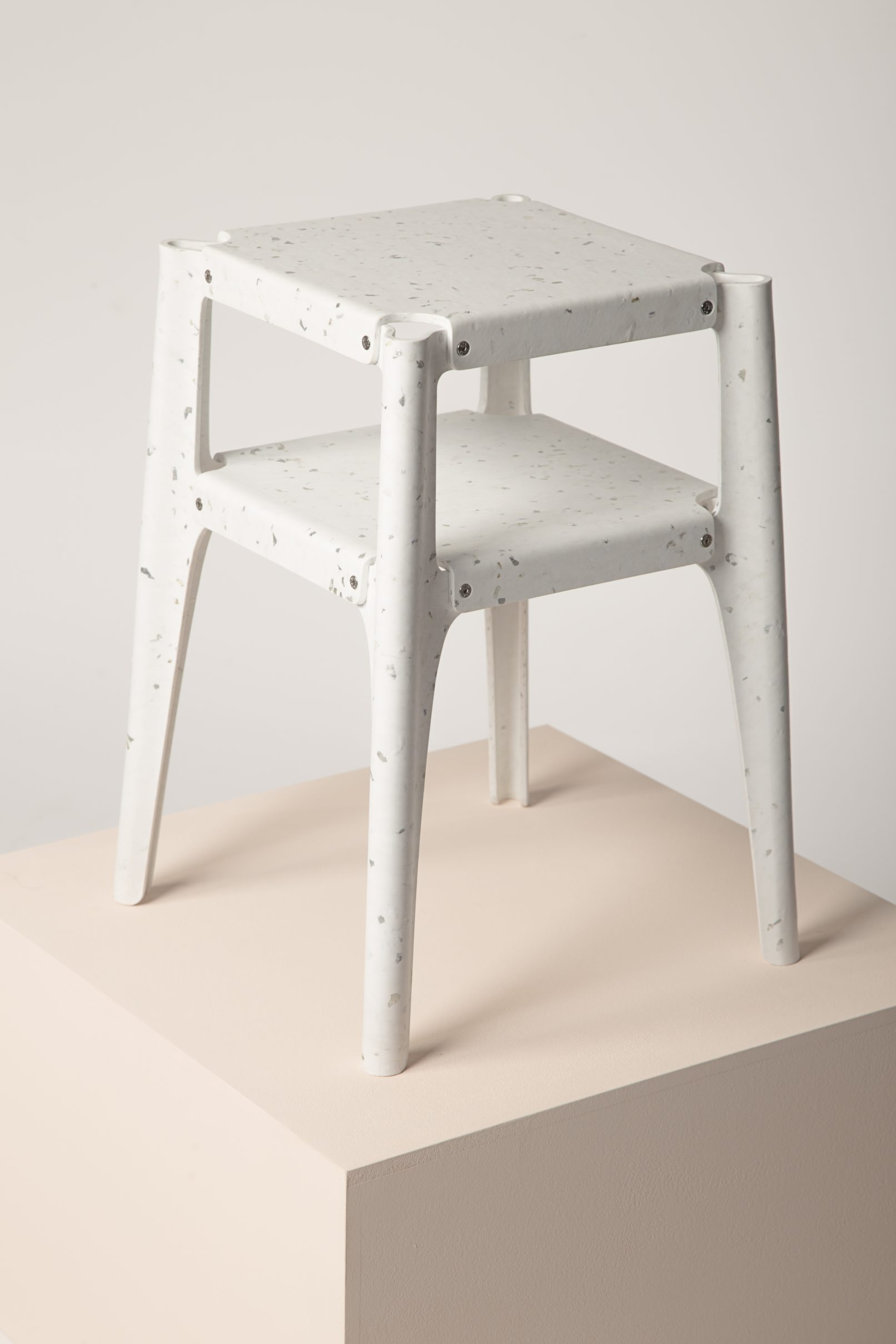 Recycled plastic stool winning the Guiltess Plastic Prize: one of the plastic recycling initiatives presented at Milan Design Week.