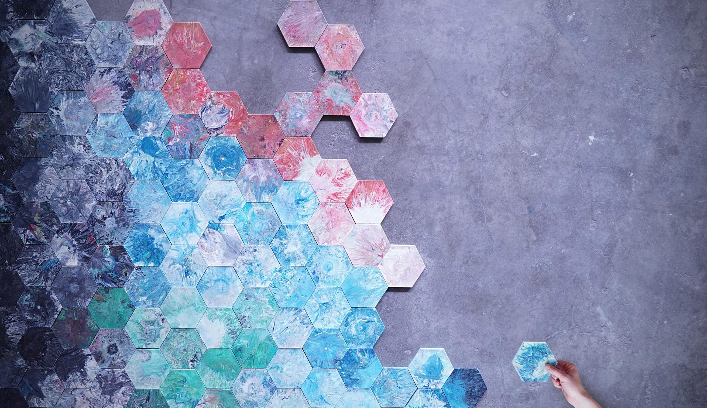 A wall of hexagonal recycled plastic tiles.