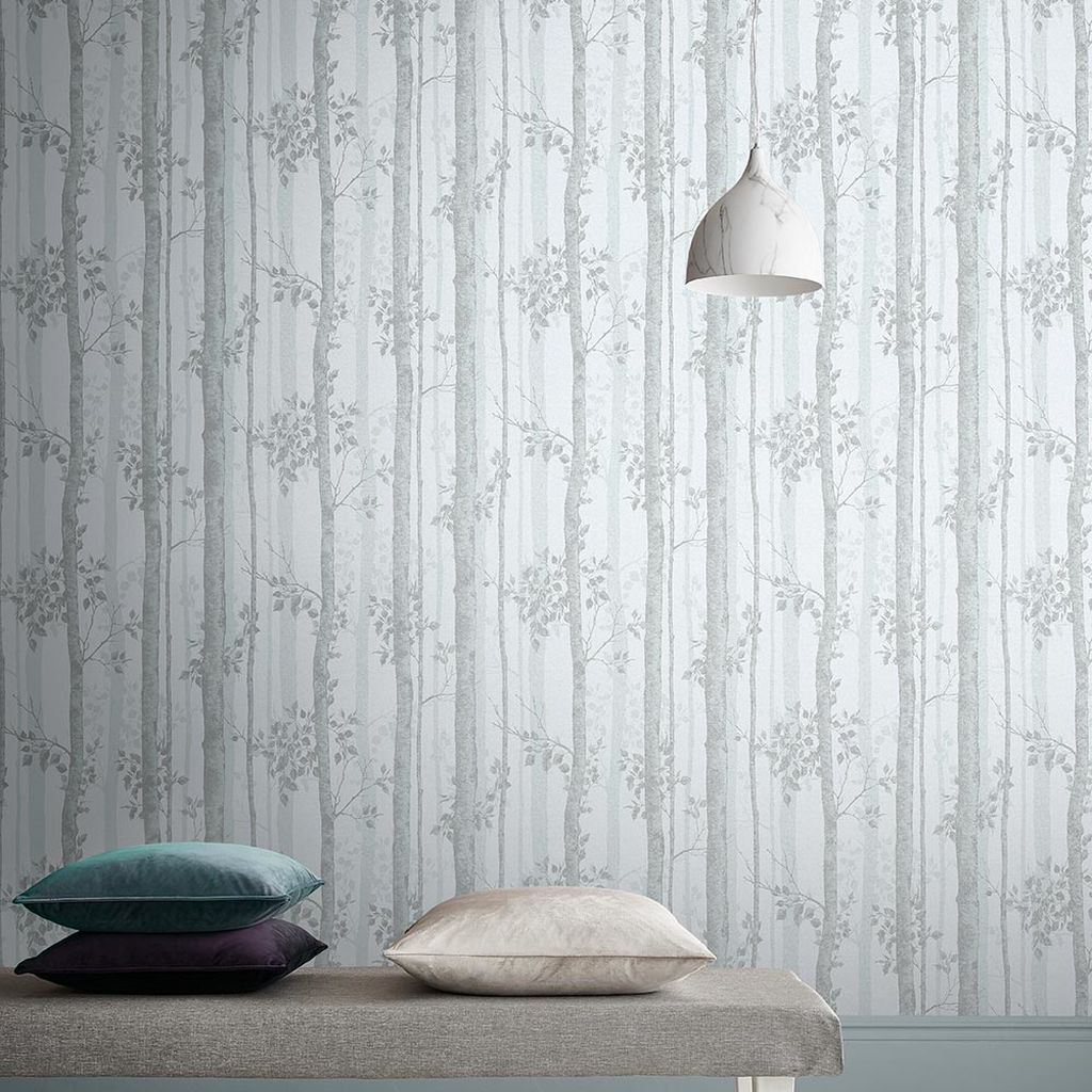 Grey wallpaper reproducing intricate branches and leaves as an example of the use of natural fractals in interiors.