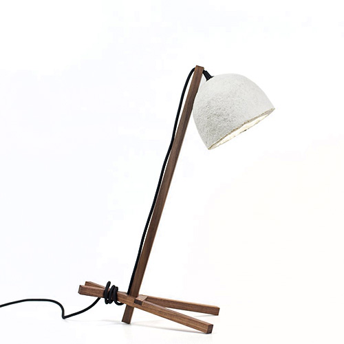 A table lamp with wood structure and mycelium base shade.