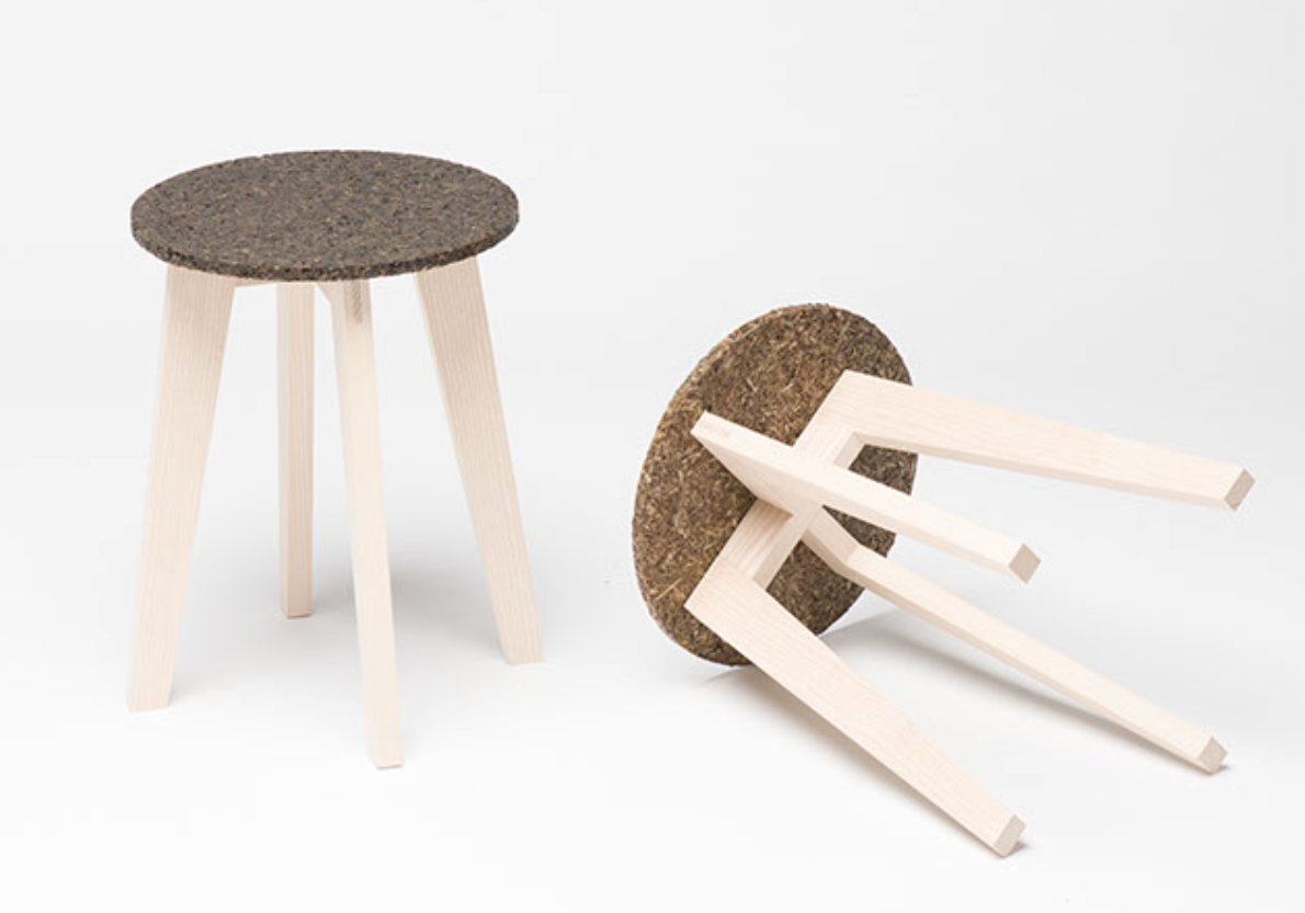 Wooden stool with seagrass seat.