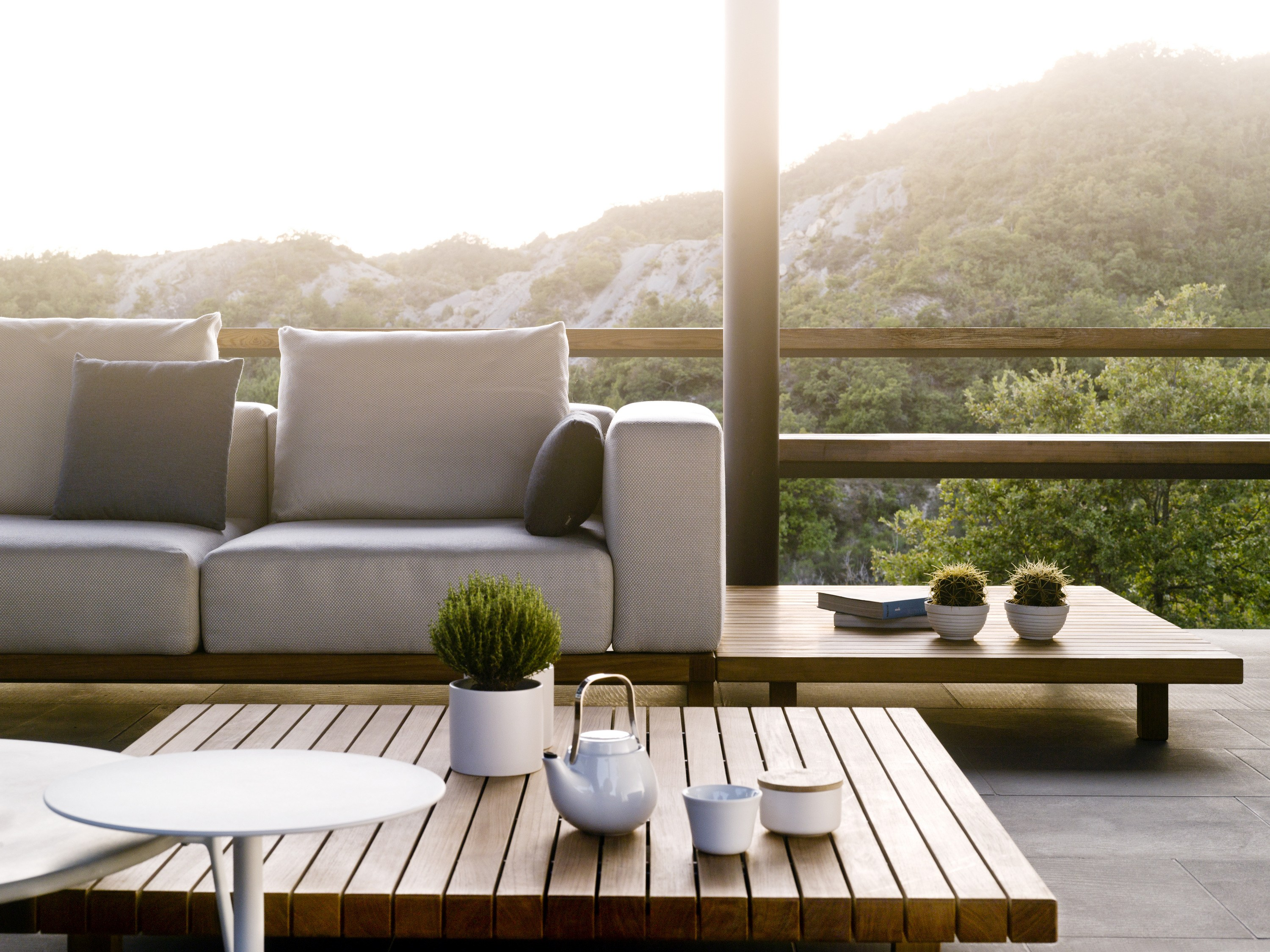 Outdoor sofa and matching coffee table in teak wood.