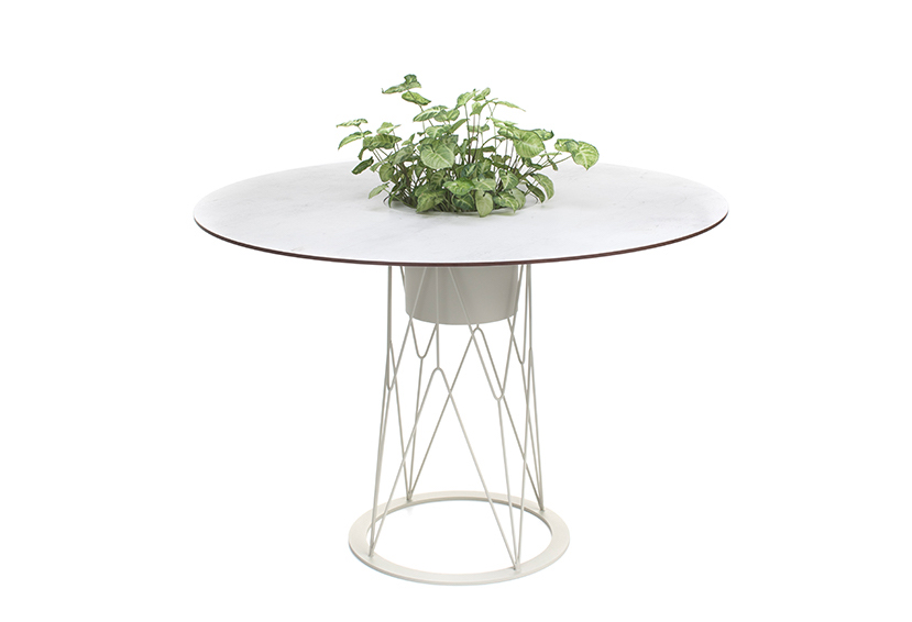 Outdoor round table with integrated planter in the center.