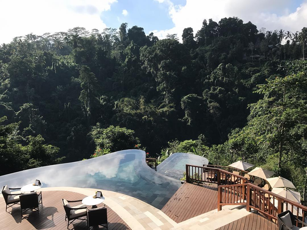 A terraced infinity pool that seems to go right into the forest.