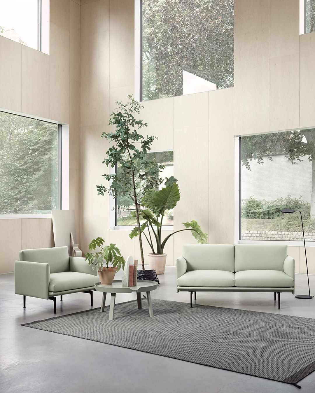 Biophilic sitting area in a room with very high ceilings and Tranquil Dawn furniture.