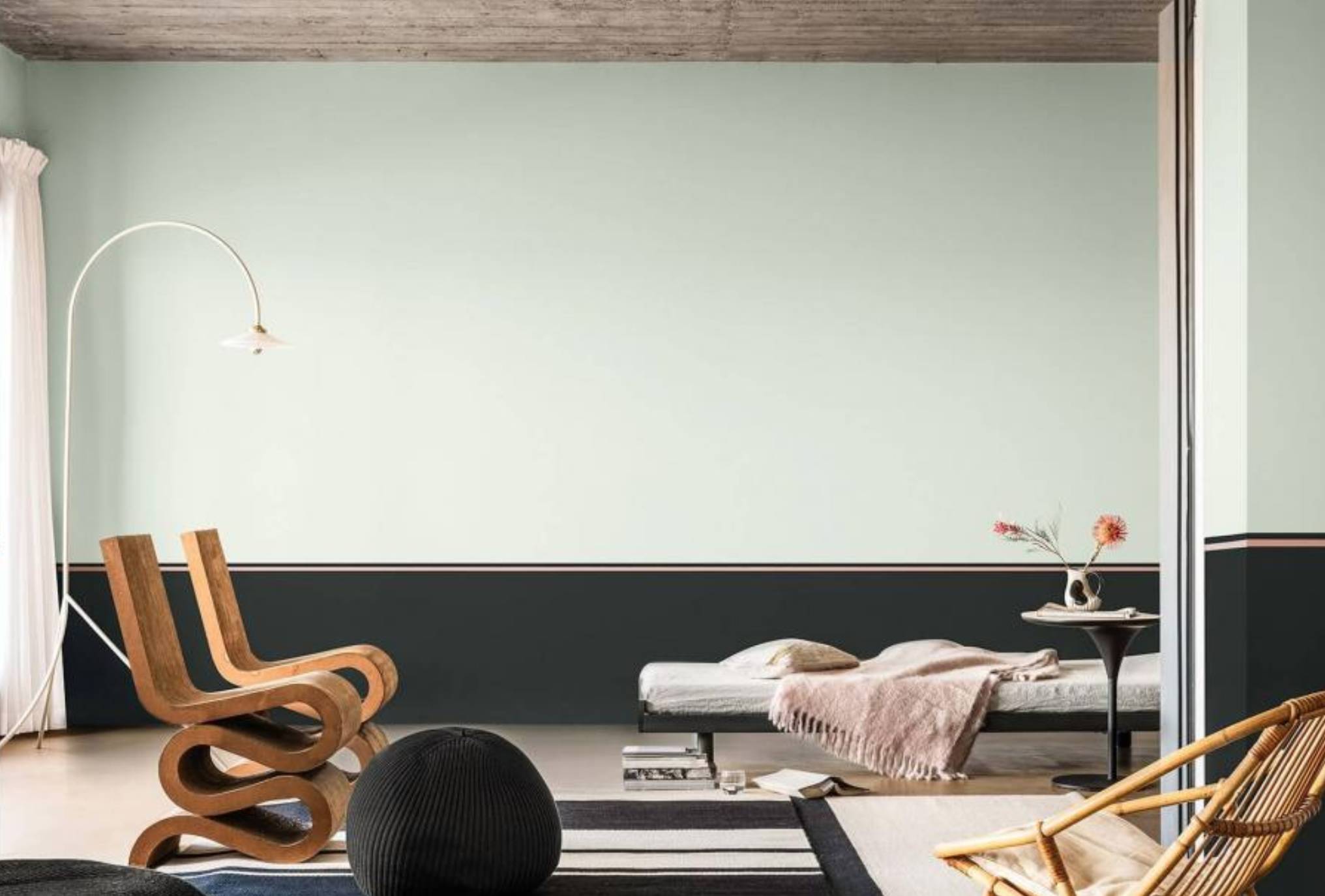 Biophilic living room with Tranquil Dawn and charcoal striped walls and minimal furniture.