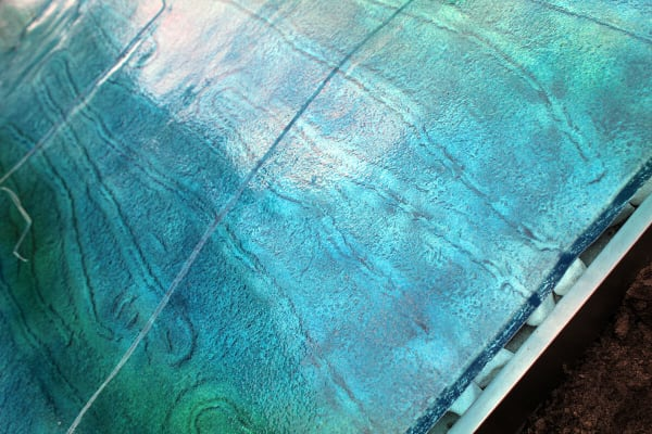 detail van glas grafzerk