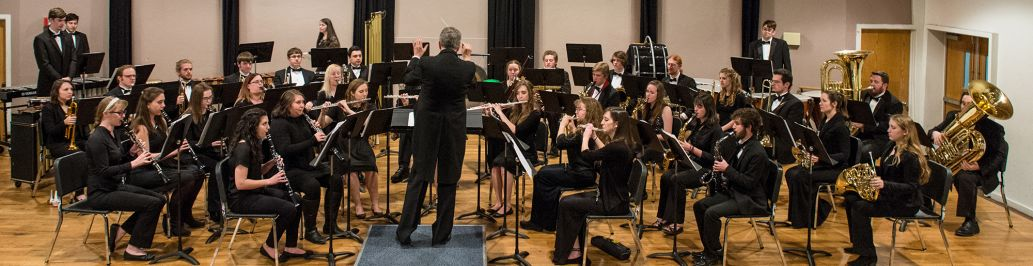 The Colorado Christian University band is performing on stage.