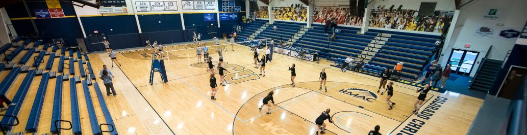 The women's volleyball team at CCU is practicing in the CCU Event Center.