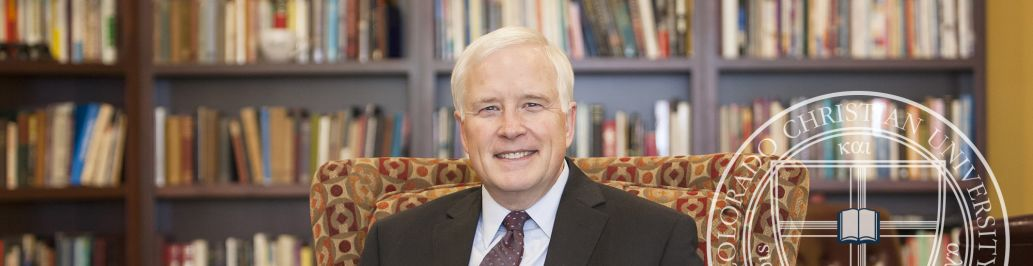 CCU's president, Dr. Donald W. Sweeting, is sitting in his office at the CCU campus.
