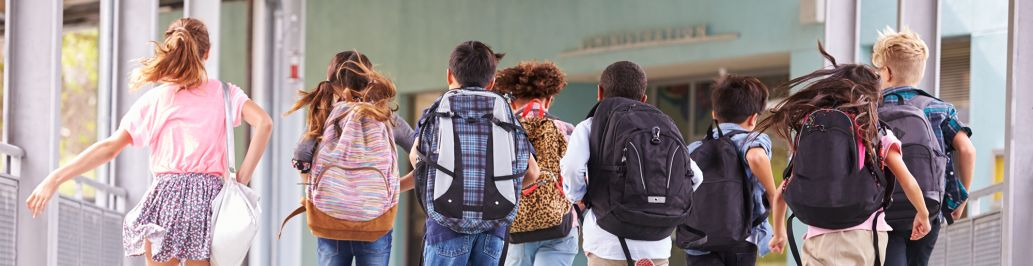 A group of special education children are going to class at school.