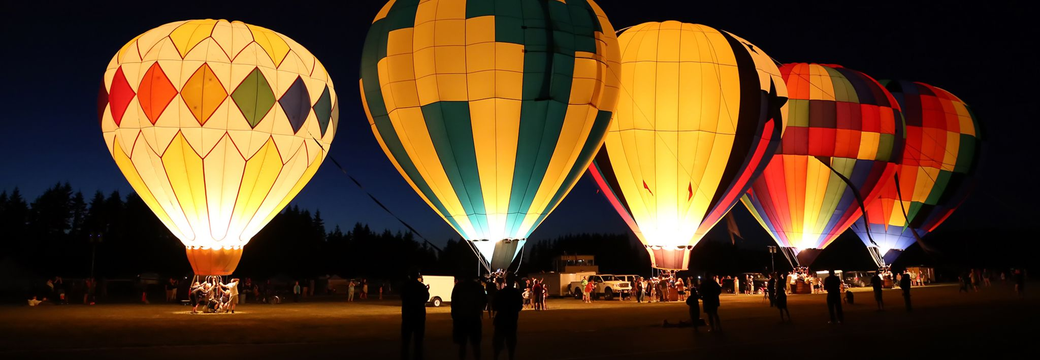 Hot air balloons are lit up on the CCU campus.