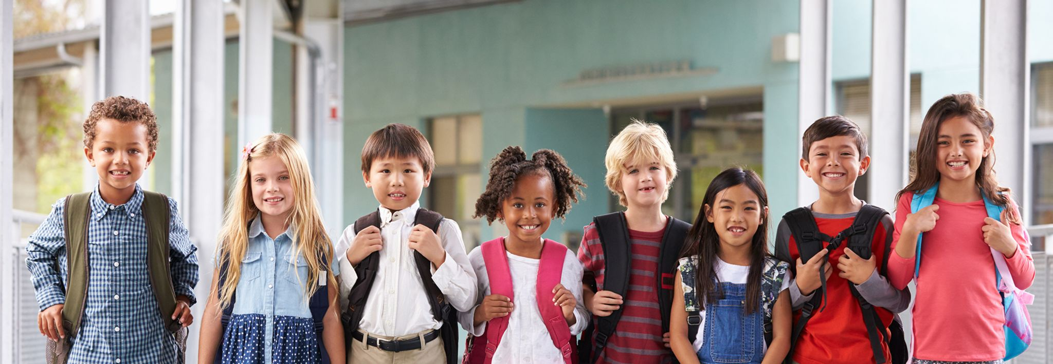 A group of children are getting ready to go into class at school.