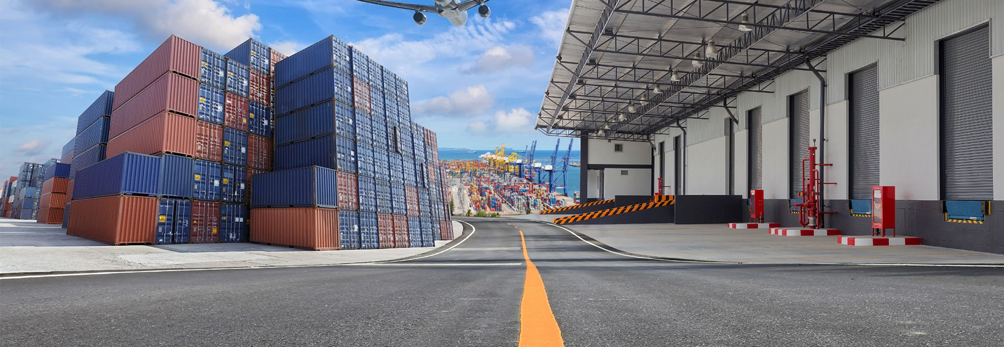 A supply chain facility has a warehouse, shipping containers, and a distribution center.