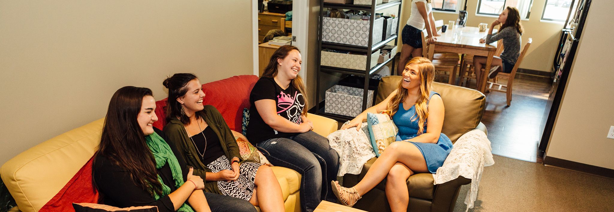 A group of roommates at CCU's Lakewood campus are chatting in their apartment.