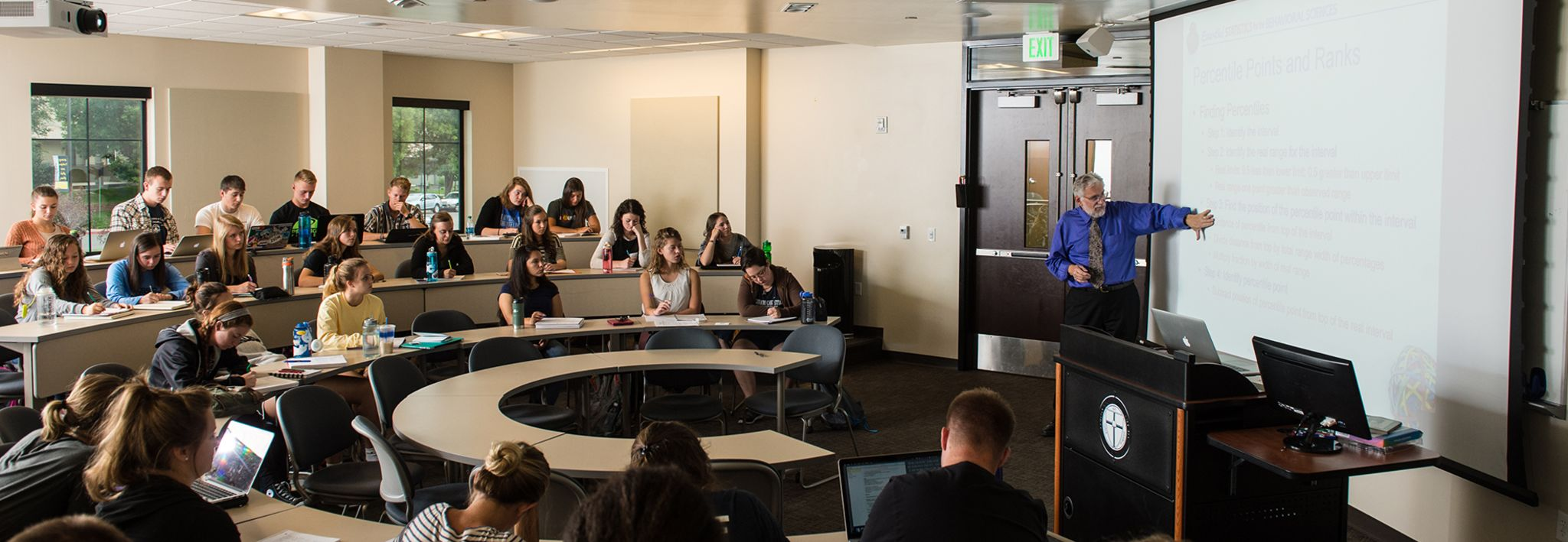 Undergraduate students sitting in class at CCU's Lakewood campus.