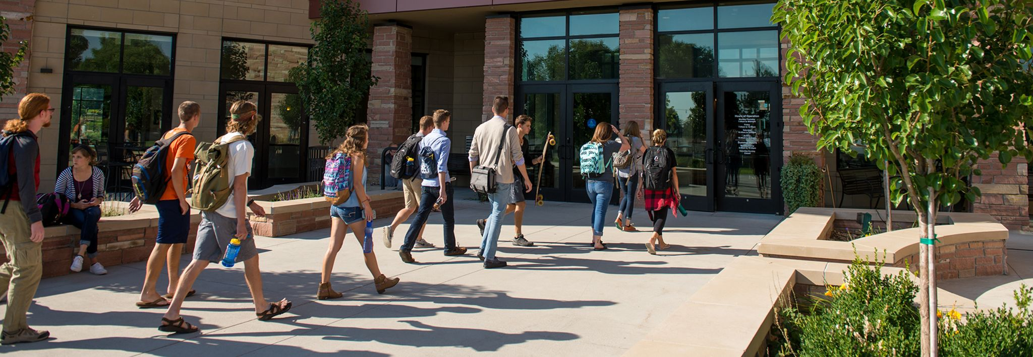 CCU undergraduate students going in to Leprino Hall.
