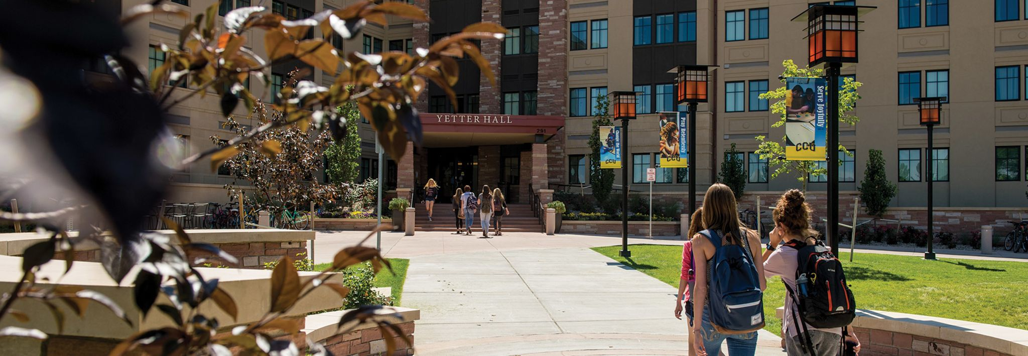 Students on walkway leading up to the entrance of Yetter Hall.