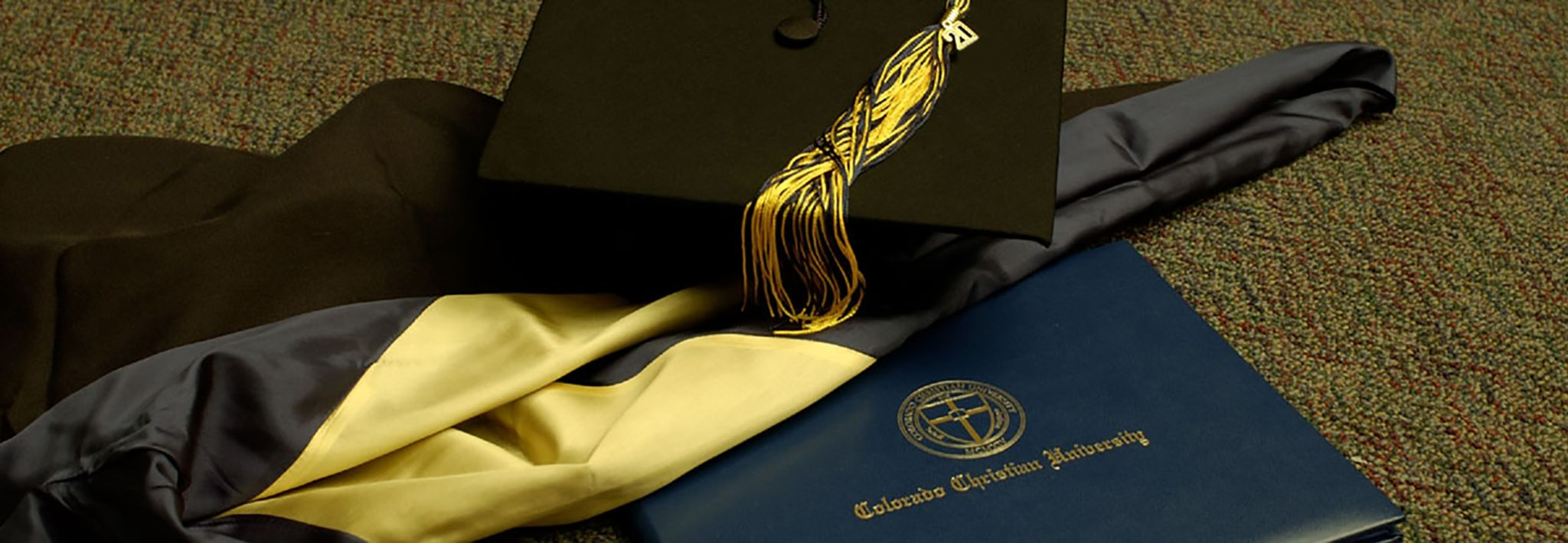 CCU cap, gown, and diploma.