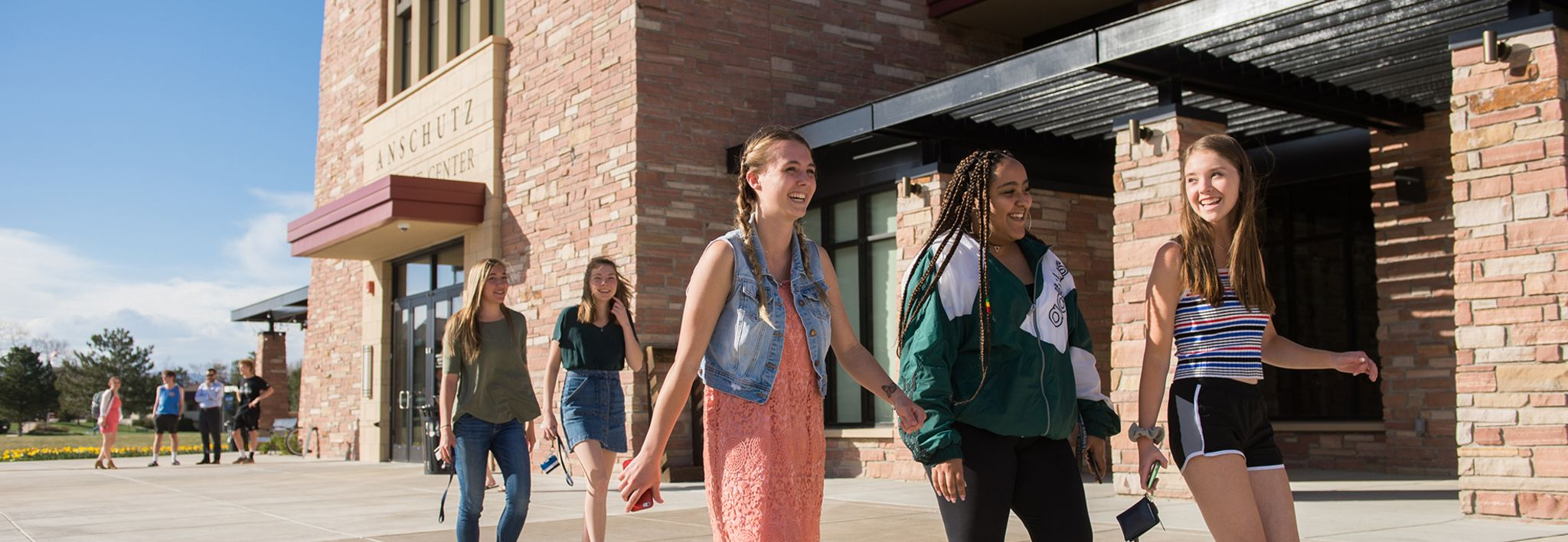 A group of female students are walking around the CCU campus.
