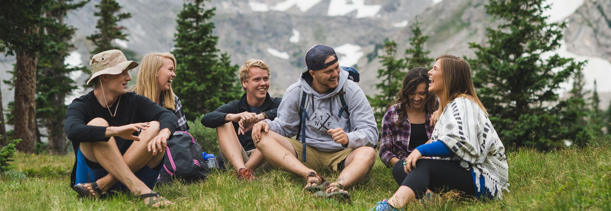 A group of CCU students sitting and chatting in the mountains of Colorado.