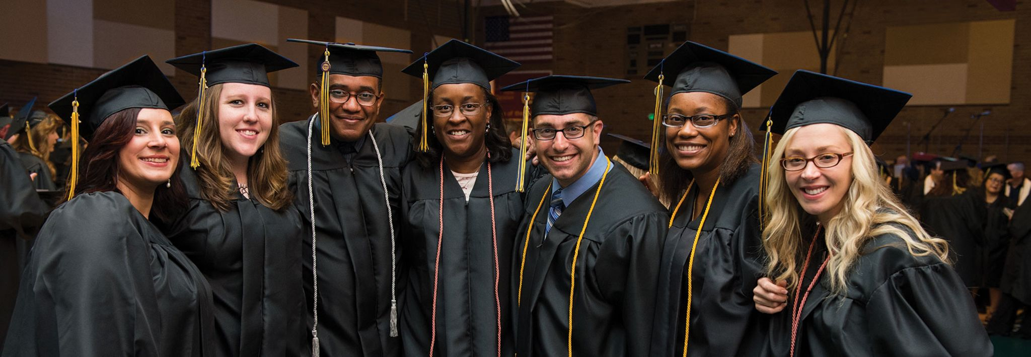 A group of CCU students is posing for a photo at graduation.