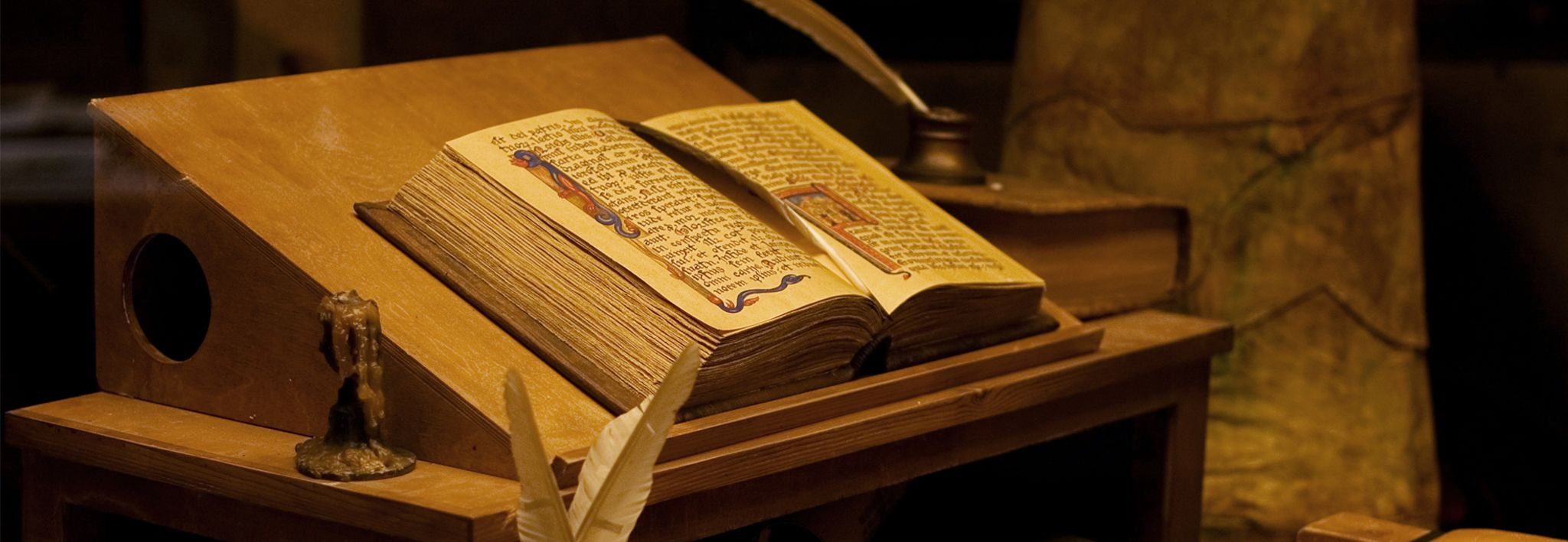 A historical Bible is open on a stand.