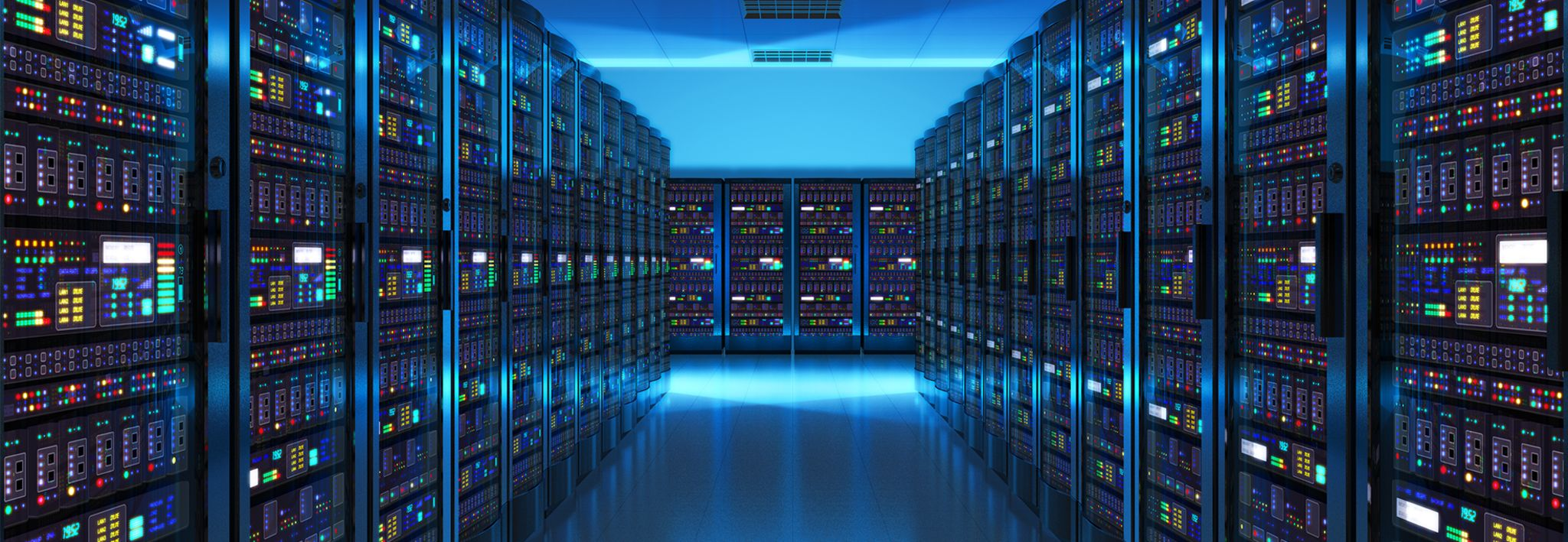 An information systems department is lined with computers and technology.