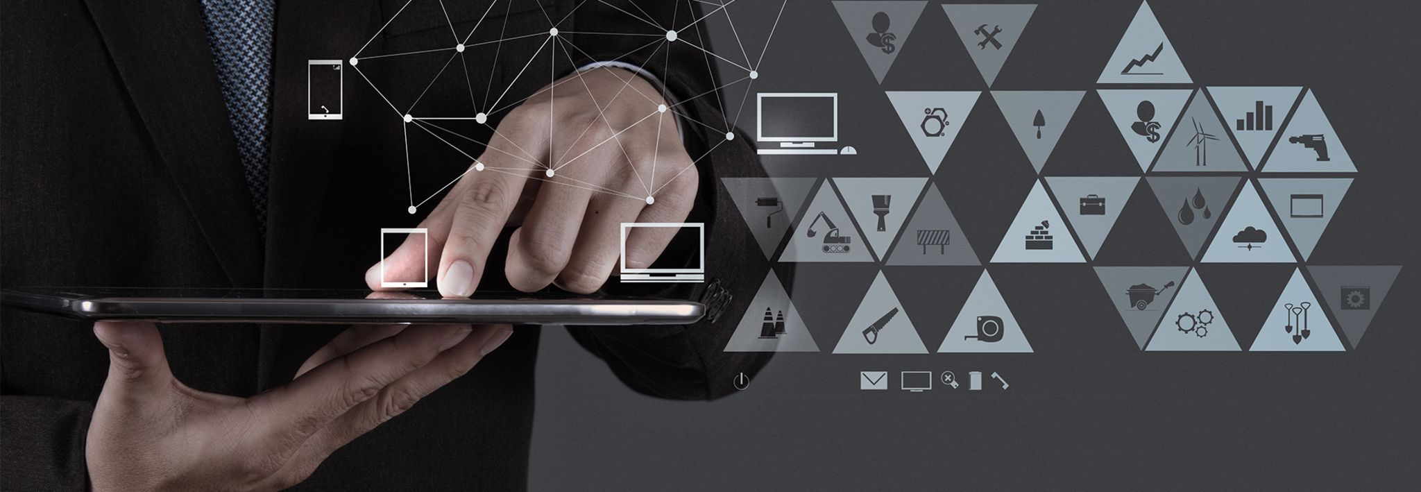 A man is holding a tablet with logistics and supply chain icons.