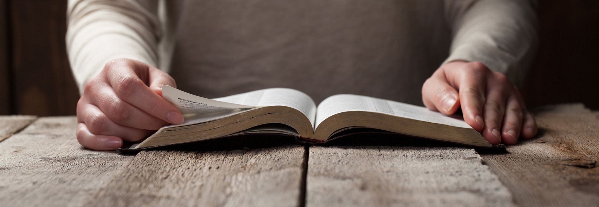 A woman has opened and is reading her Bible.