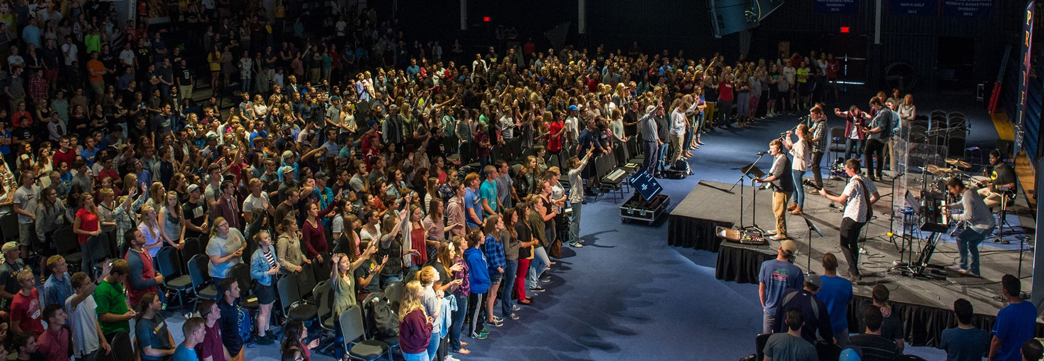 Colorado Christian University students worshiping in chapel.