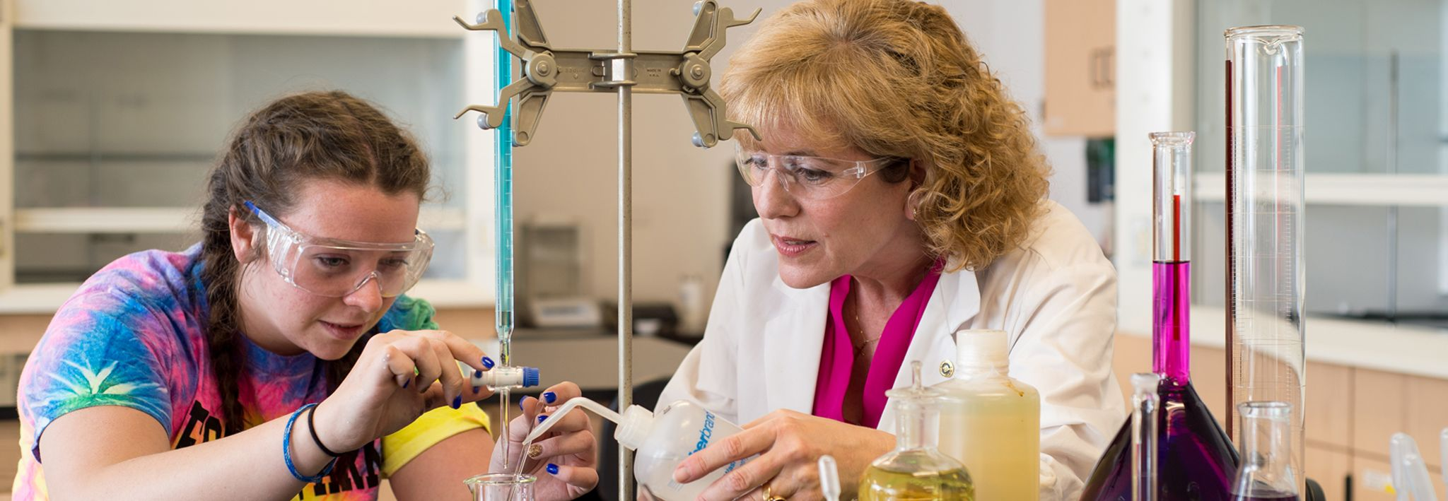 CCU professor helping a student with her lab project.